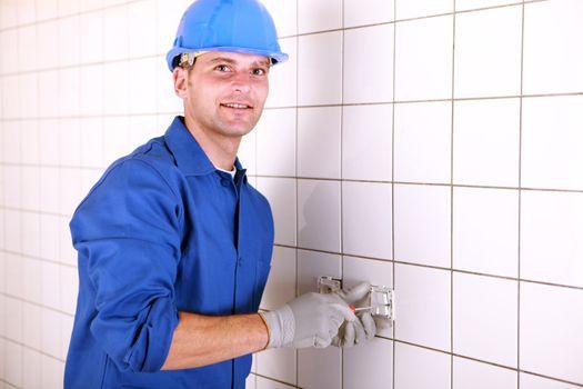 Electrician installing a socket