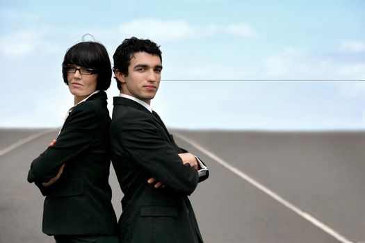 Two businesspeople stood on runway