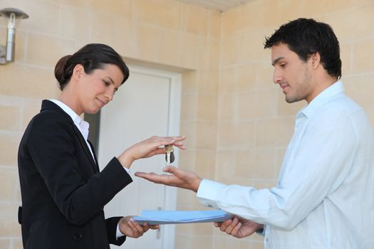New property owner receiving the keys to his property