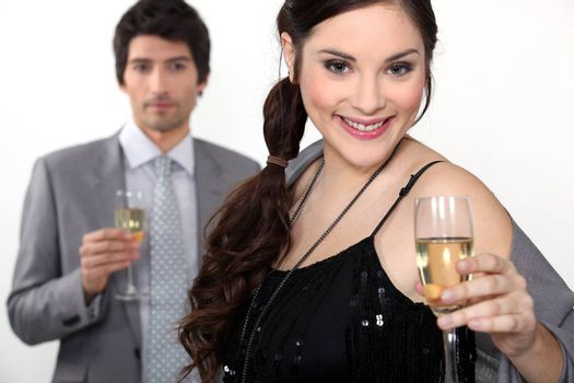 Man and woman drinking champagne for a celebration