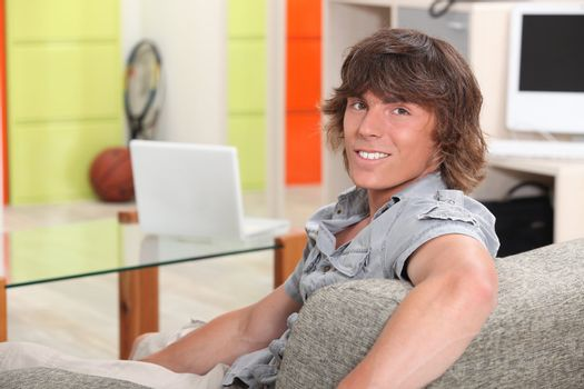 Young man sitting in a recreation room at college
