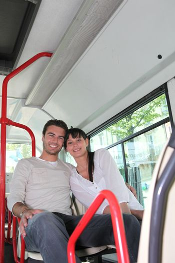 Couple sat on the bus