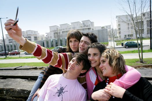 Group of teenagers hanging out on bench