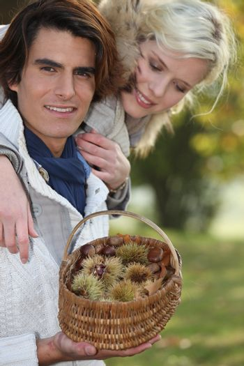 Couple picking chestnuts