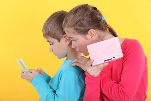 Children with handheld computer games