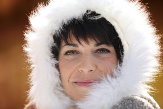 Woman with fluffy hood