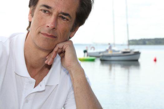 Man thinking by boating lake
