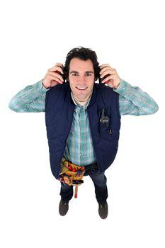 Worker wearing ear defenders