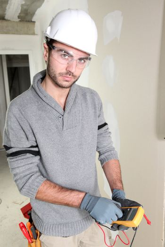 Builder using a voltmeter
