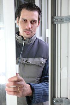 Worker installing a door