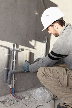 Plumber repairing water supply