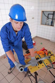 Plumber preparing plastic piping