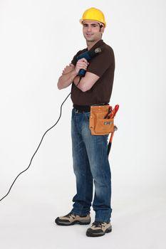 Worker with a heat gun