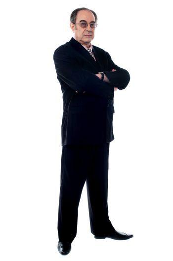 Matured businessperson posing with crossed arms