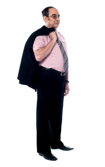 Senior executive holding his coat over shoulders
