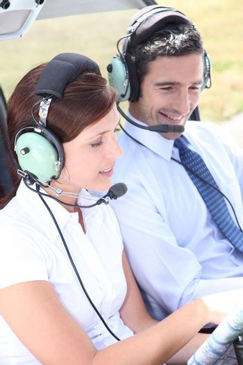 Couple in the cockpit of a light aircraft