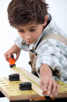 Boy doing carpentry