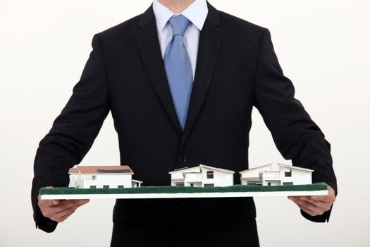 Architect with model housing