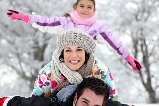 Family having fun outdoors on a cold winter's day