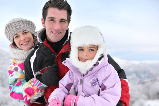 Family in snowsuits