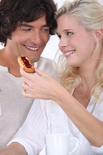 Couple eating biscuit's for breakfast