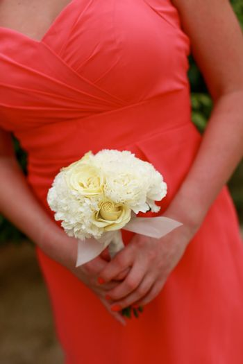 Close-up of a bridesmaid holding their wedding bouquets.