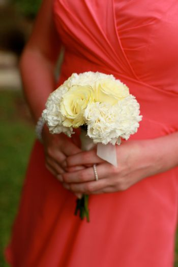 Close-up of a bridesmaid holding her wedding bouquet.