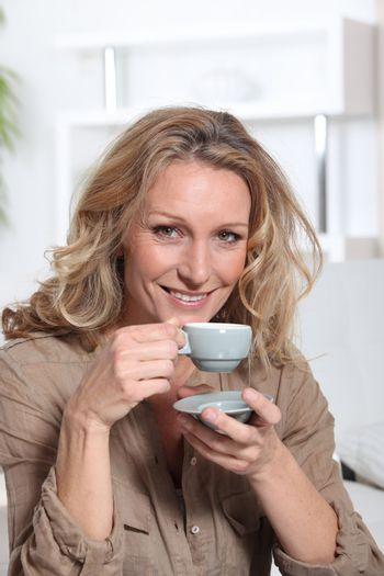 Woman drinking an expresso