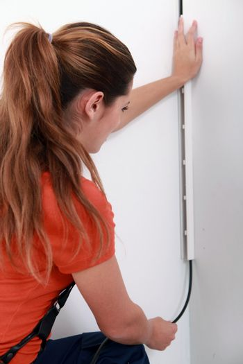 woman installing cable