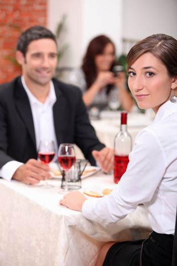 couple at restaurant with woman turned to camera