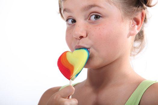 Little girl holding lollipop