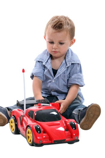 Little boy with a remote controlled car