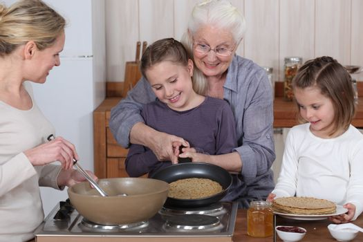 Family cooking pancakes