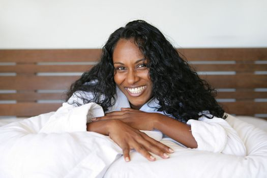 Black woman laying on her bed