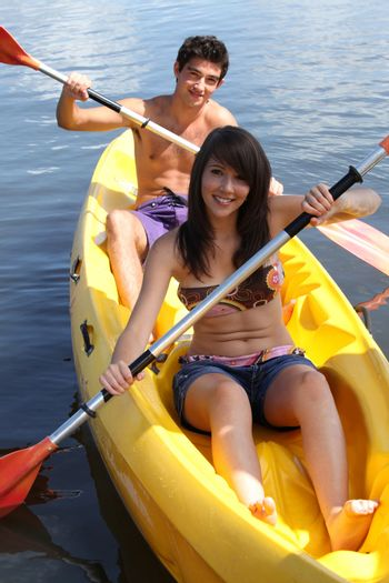 young couple canoeing