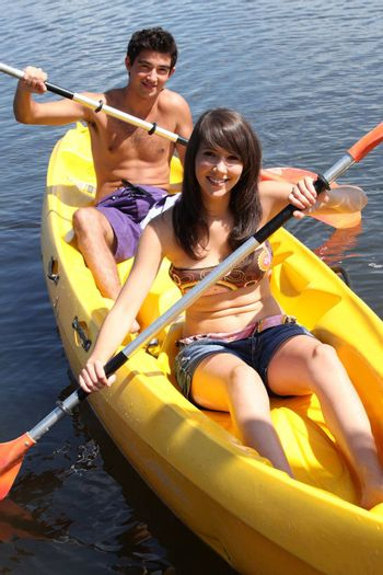 girl and boy canoeing together