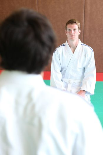 Pair of young men starting a bout of judo
