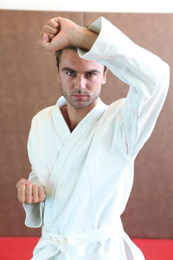 Man wearing martial arts clothing stood in defence stance