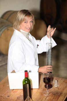 Wine expert in a cellar