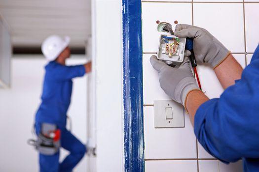 Worker installing a plug