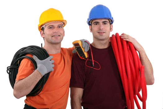 Two electricians with equipment