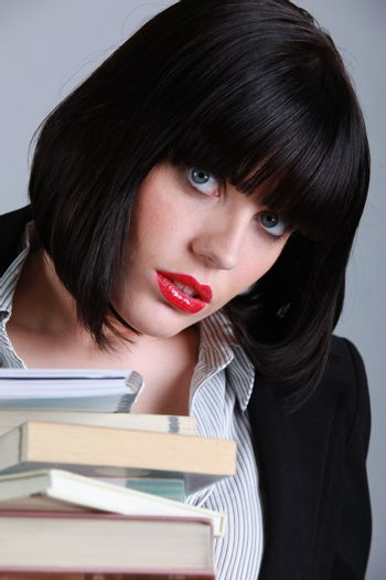 Brunette woman with stack of books