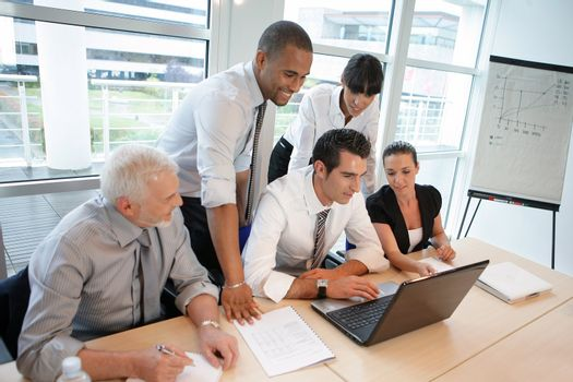 Business team looking at financial report on-line