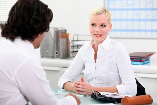 Young woman meeting employer