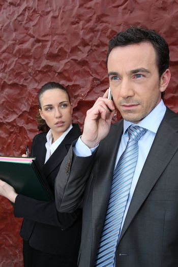 a manager at phone and his assistant