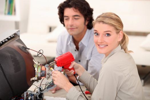 Woman soldering television