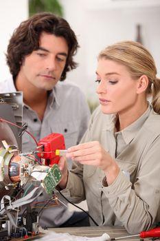 Woman repairing a television set