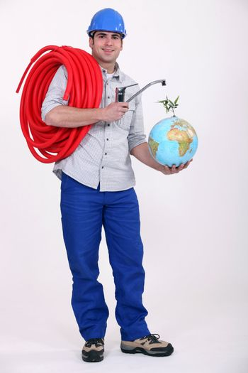 Plumber installing a worldwide water supply system