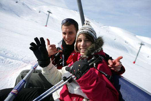 duo at ski in ski lift
