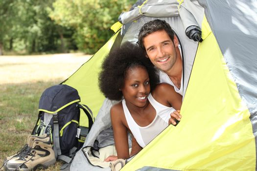Couple with tent on camp site